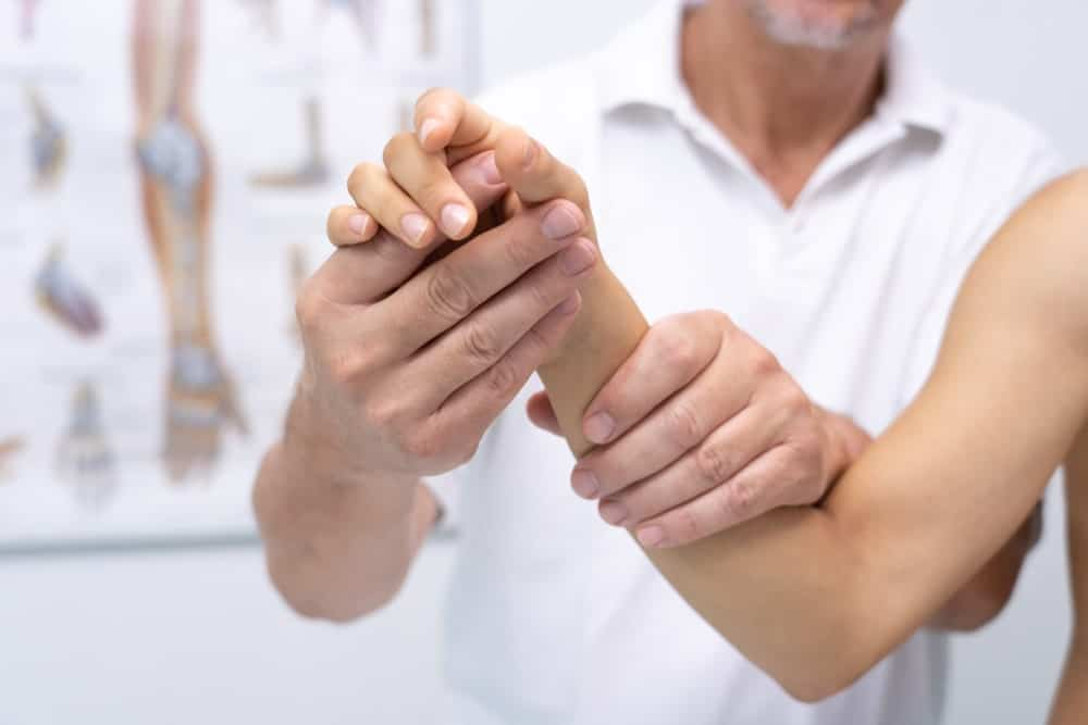 Physical therapy applied on the hand.