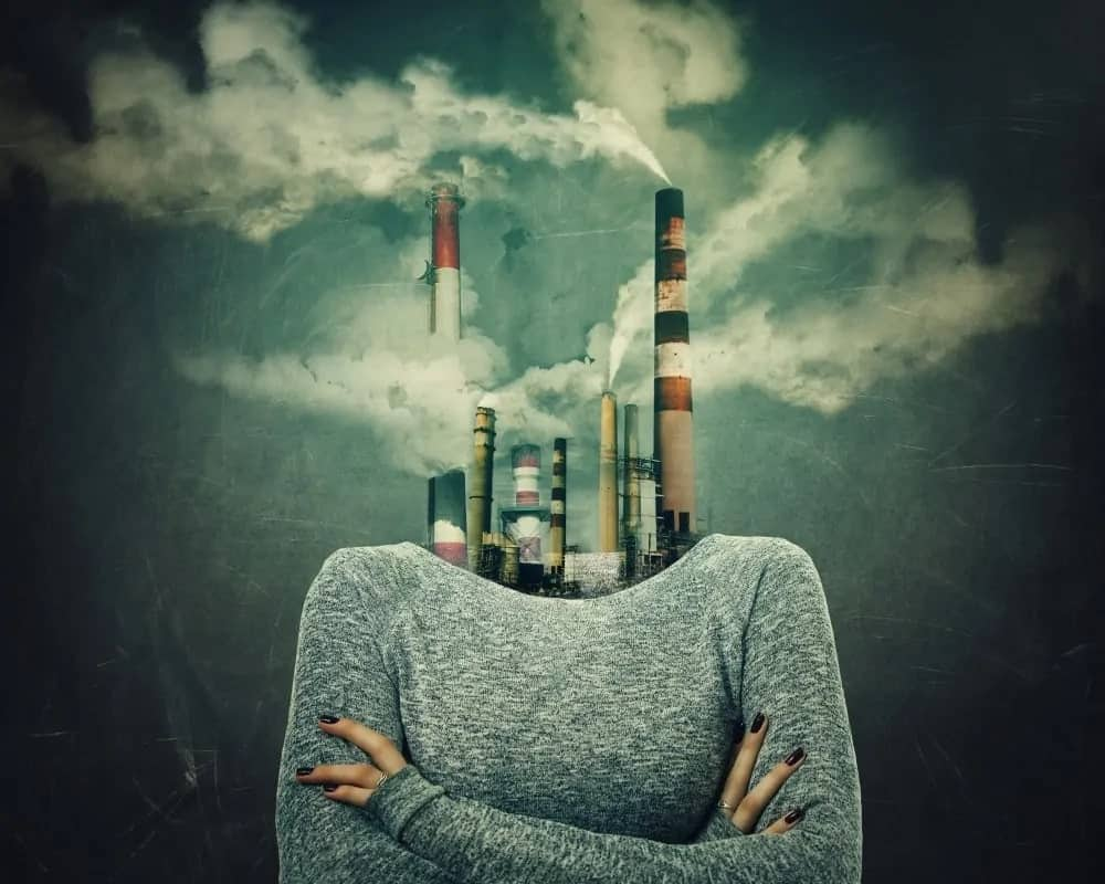 An artistic representation of air pollution through a woman's body with factories emitting harmful gases as her head.