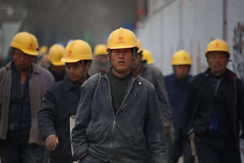 Chinese workers in a mining site.