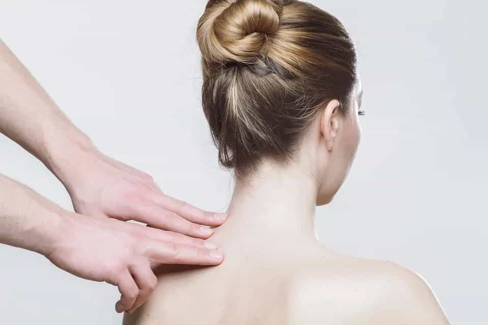 Flexion distraction therapy applied to injured woman