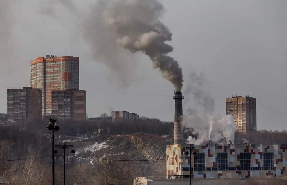 Industrial factories emitting greenhouse gases.