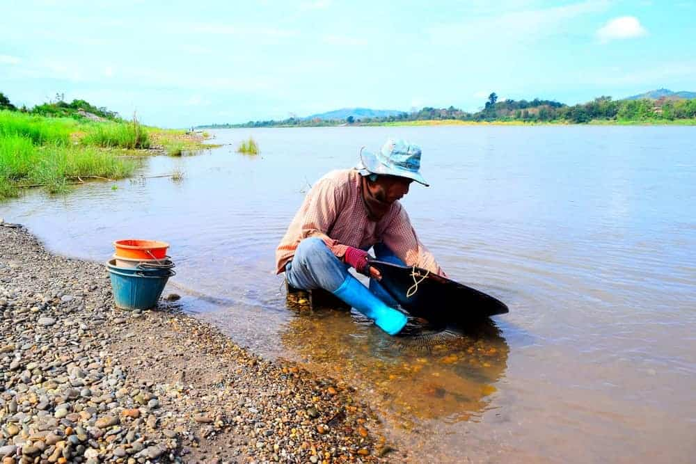 Man panning gold in the Mekong river.