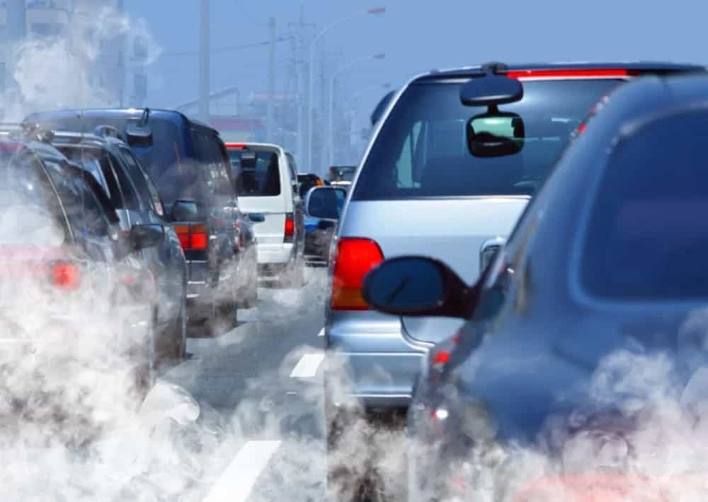 A traffic jam of cars emitting harmful gases.