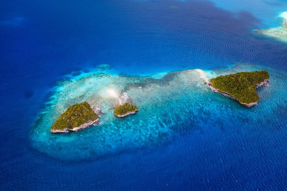 An aerial view of the pacific ocean and the Palau Islands.