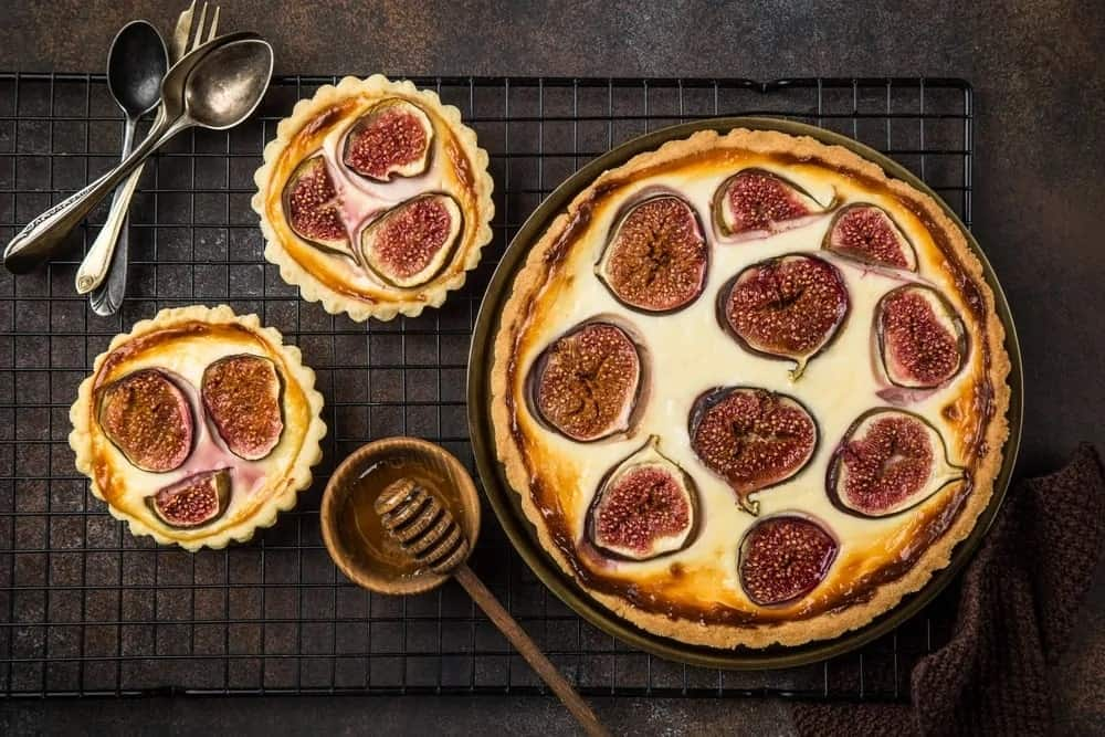 Top view of fig cheesecake with honey.