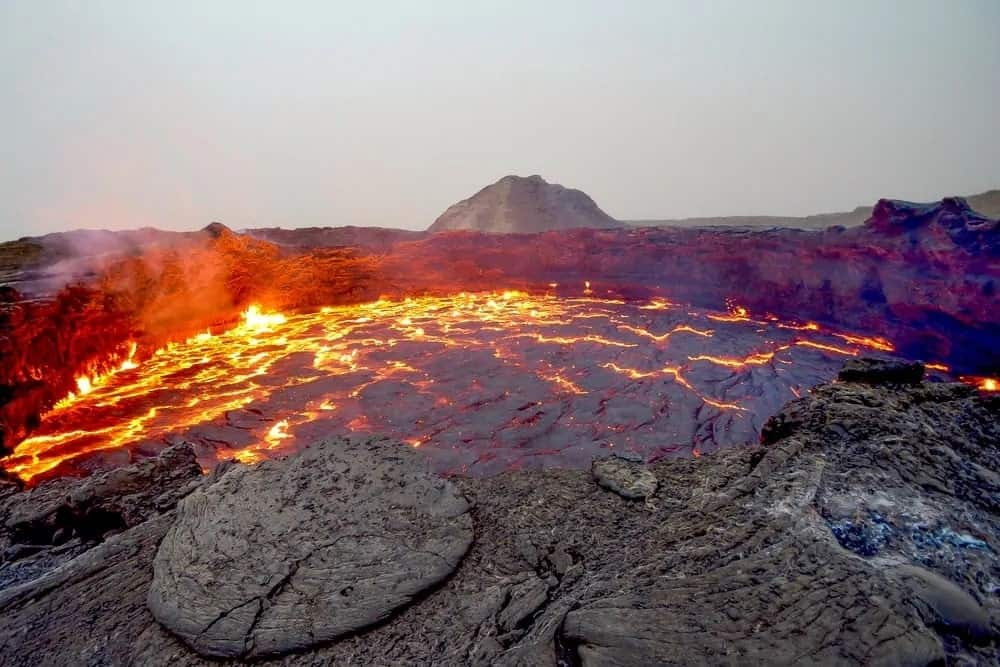 Shield volcano with lava flow.