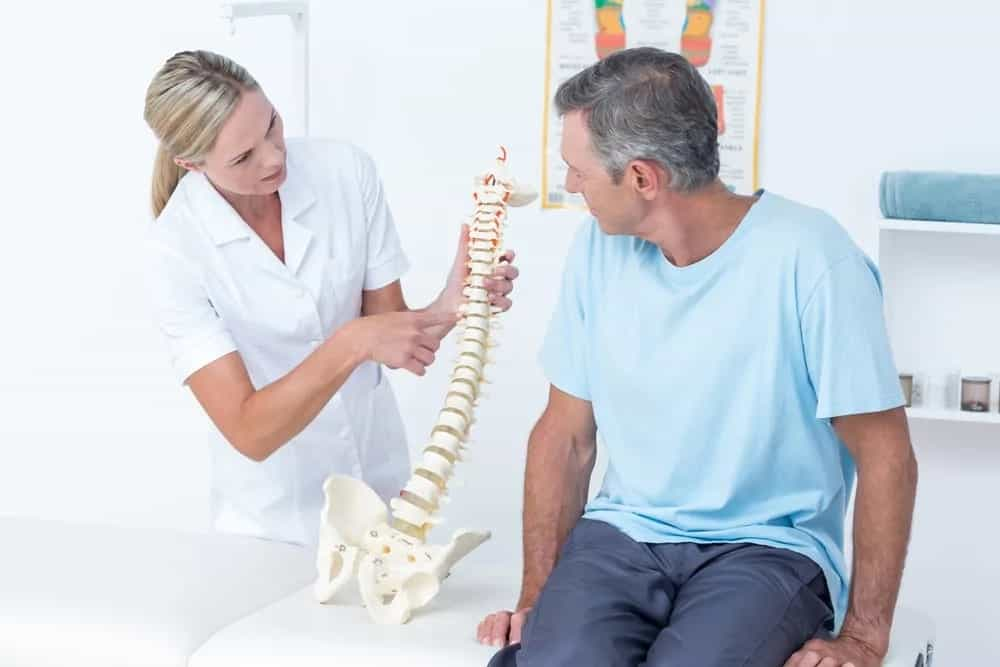 Chiropractor explaining treatment to patient