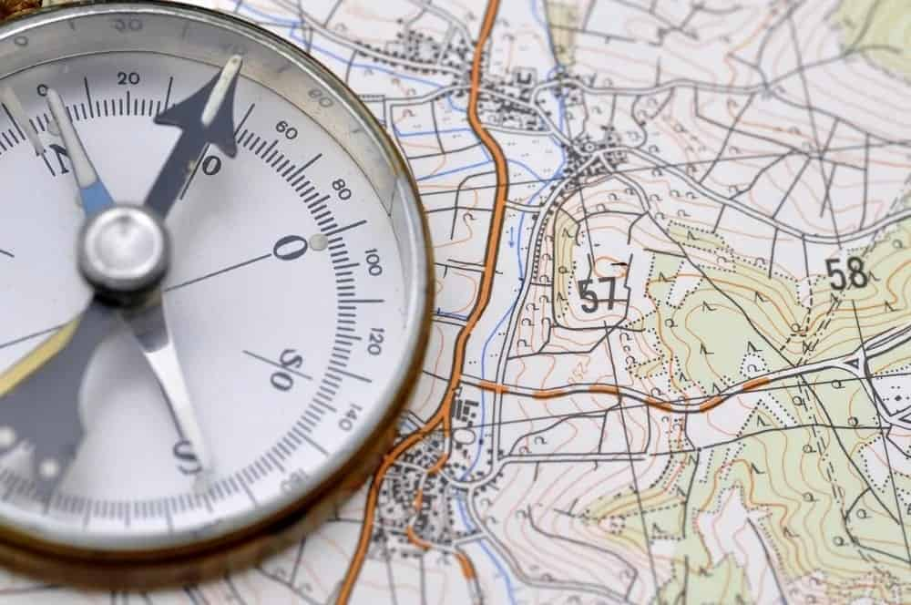 A compass on top of a reference map