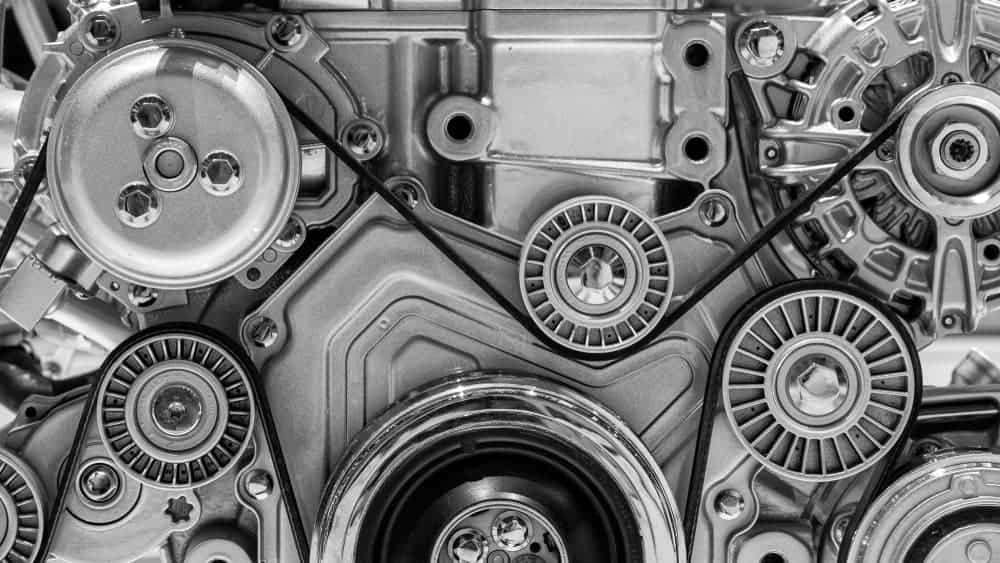 Complex pulley system in a car engine.