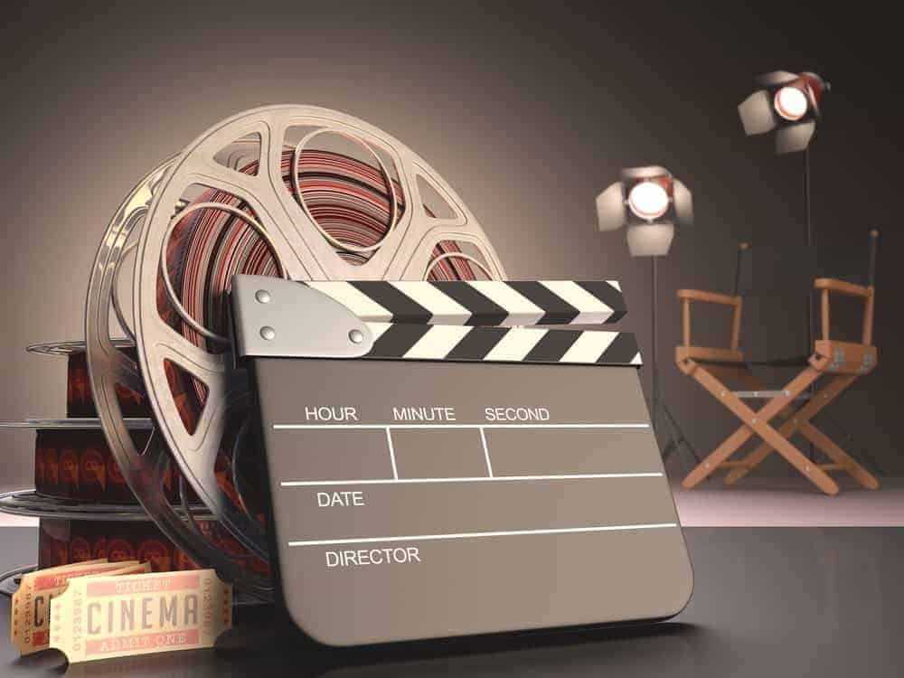 Movie reel, action board, movie tickets, lighting, and director's chair.
