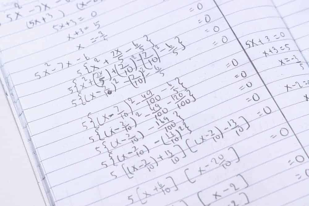Exponential equation written on the notebook.