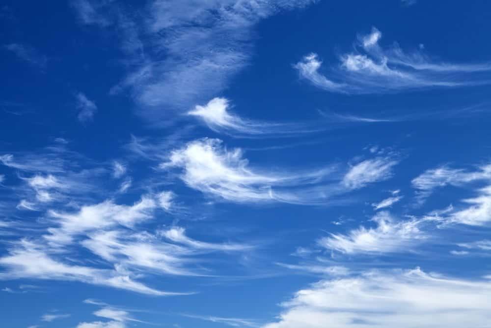 A bunch od cirrus clouds against a blue sky.