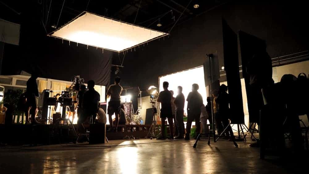 On set while filming at an indoor location.