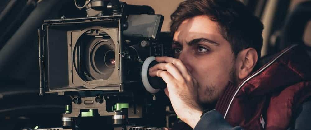 A man looking intently behind the camera.
