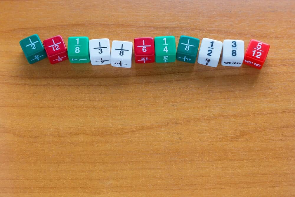 Proper fractions written on multicolored dice.