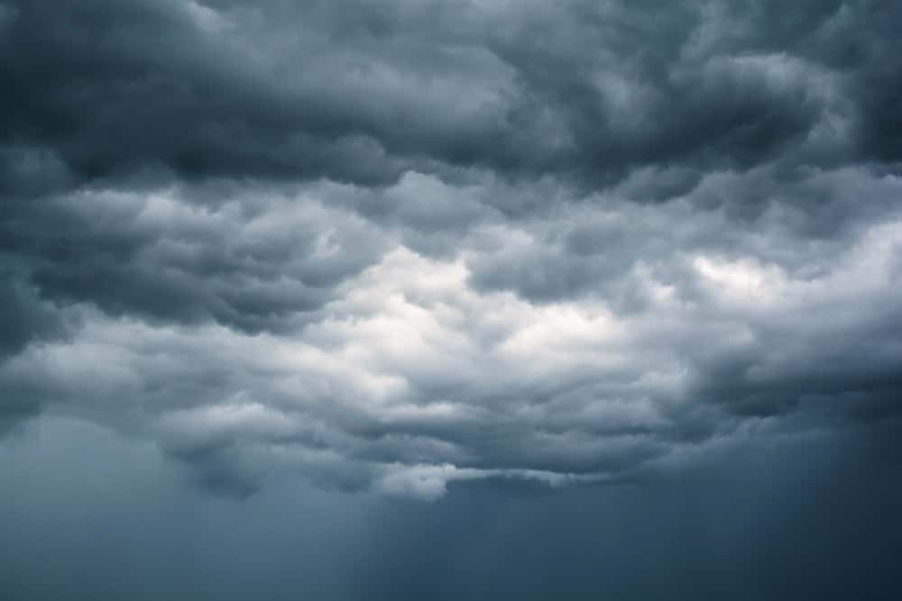 A close look at thick blue gray and black clouds in the sky.