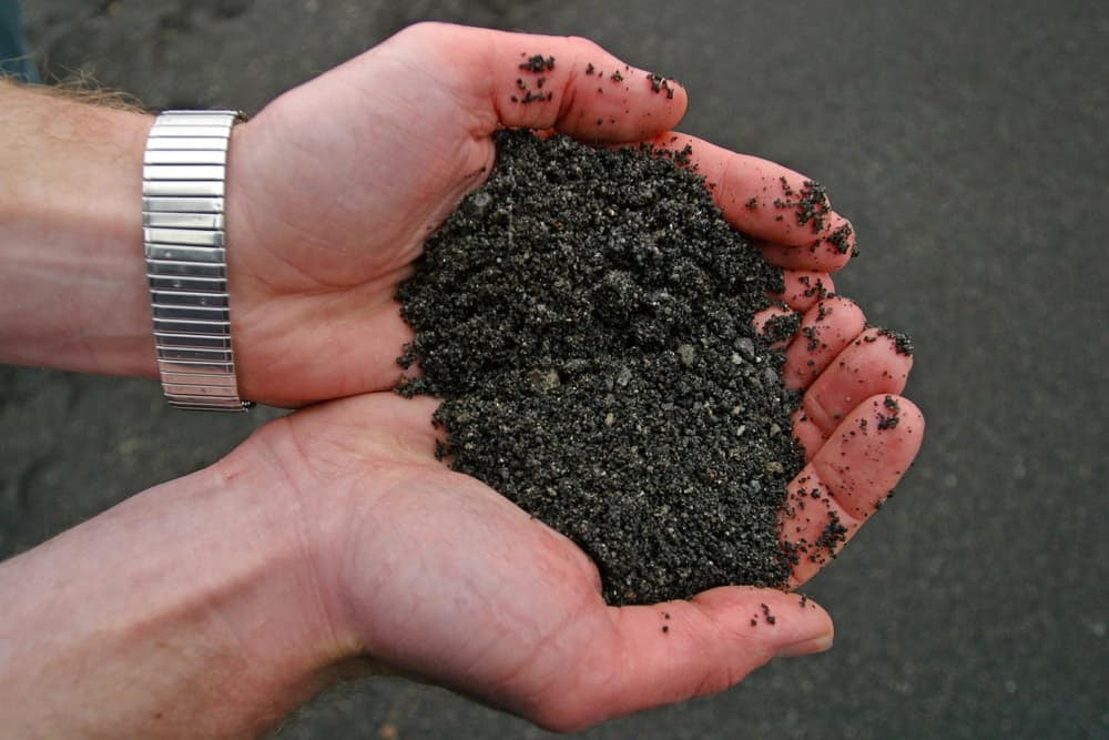 A close look at a handful of volcanic soil.