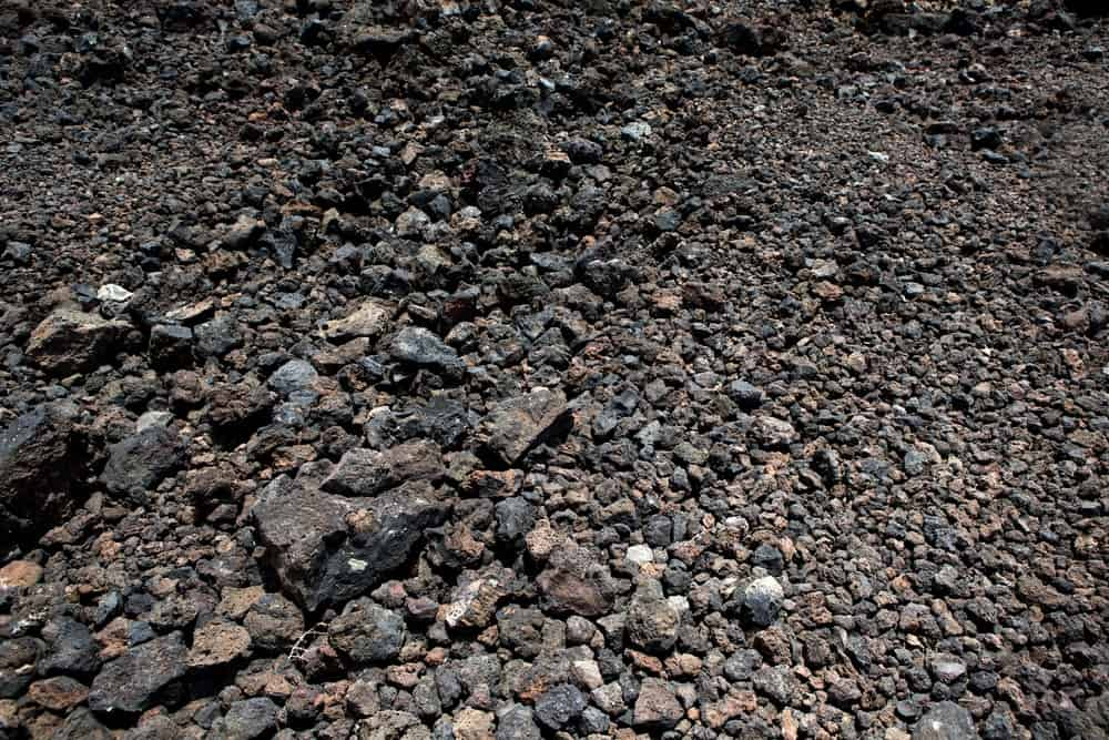A close look at black volcanic stones and soil.