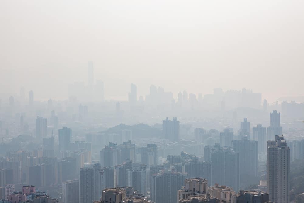 An aerial view of the skyscrapers of Hong Kong hidden behind haze.