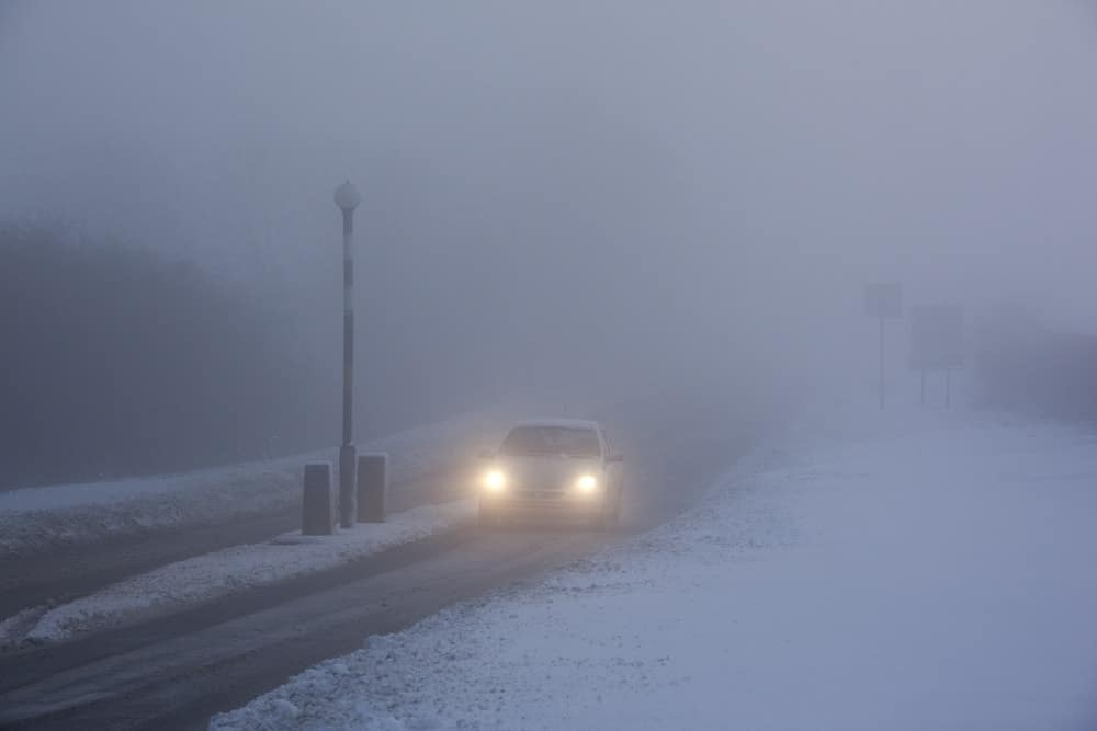 A view of a foggy street during winter.